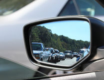 Side traffic. Traffic in scene from the driver side-view mirror Royalty Free Stock Images