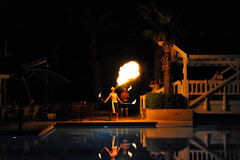 Side, Turkey - April 10, 2014: Fire show artist breathe fire in the dark in a luxury hotel Crystal Admiral Resort in Side. Turkey. stock photo