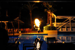 Side, Turkey - April 10, 2014: Fire show artist breathe fire in the dark in a luxury hotel Crystal Admiral Resort in Side. Turkey. Royalty Free Stock Photo