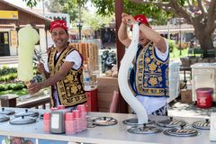 Turkish men selling traditional turkish icecream on a street in. SIDE, TURKEY - april 19, 2012: Turkish men in turk costumes  selling traditional turkish Stock Image