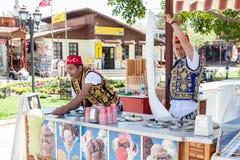 Turkish men selling traditional turkish icecream on a street in. SIDE, TURKEY - april 19, 2012: Turkish men in turk costumes  selling traditional turkish Stock Photo
