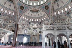 Turkish Muslims pray  in a mosque in Side, Turkey. SIDE, TURKEY - april 19, 2012: Turkish Muslims pray  in a mosque in Side, Turkey Stock Photos