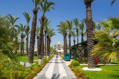 Beautiful garden area of the TT Pegasos World resort near Side, Turkey. Side, Turkey - June 7, 2018: Beautiful garden area of the TT Pegasos World resort near stock photography