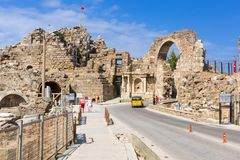 Side, Turkey - June 11, 2018: People on the main road to Side town at sunny day, Turkey. Side  is an ancient Greek city on the. Southern Mediterranean coast of royalty free stock images