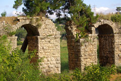 SIDE, TURKEY - June, 2014: Roman aqueduct near Manavgat Royalty Free Stock Photo