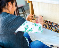 Side, Turkey - May 24, 2015: An unidentified woman weaves a carp Stock Images