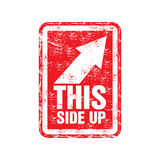 This side up rubber stamp. Red grunge rubber stamp with an arrow showing the right up corner and the text this side up written inside the stamp Royalty Free Stock Image