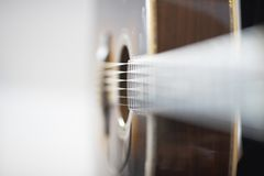 Side view of an acoustic western guitar Stock Images