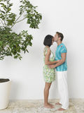 Side View Of Affectionate Young Couple Stock Photo