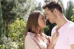 Side view of affectionate young couple looking at each other in park Royalty Free Stock Images