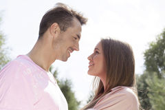 Side view of affectionate young couple looking at each other in park Stock Images