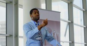 Male speaker speaking in a business seminar 4k. Side view of an African american male speaker speaking to the public in a business seminar 4k stock footage