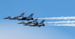 Side view of Air Force Thunderbirds flying close together royalty free stock images