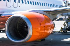 A side view of a airplane engine in the ground stock photo