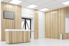 Side view of an airport lobby with poster. Side view of an airport waiting room with a desk, a TV set, a door, a poster and a rope. Concept of travelling. 3d Stock Photos