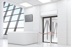 Side view of airport lobby with white walls. Side view of an airport waiting room with a desk, a TV set, a door and a rope. White walls. Concept of travelling Stock Photos