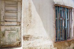 Side view of an alley with a door and a window royalty free stock image