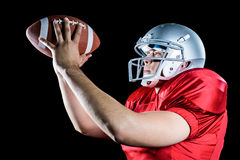 Side view of American football player throwing ball Stock Images