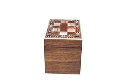 Side View of an Antique General Purpose Wooden Box. A cut-out of a vintage general purpose box with lock and ornamental tile laced lid in side view royalty free stock photography