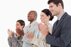 Side view of applauding salesteam standing together Royalty Free Stock Photo