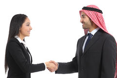 Side view of an arab saudi businesspeople handshaking. Isolated on a white background Royalty Free Stock Photography