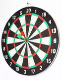 Side view.Arrow dart hitting the center of the target dart Board. The concept of purpose Stock Image