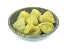 Side view of artichoke hearts in a bowl Royalty Free Stock Photos