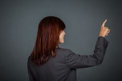 Side view of Asian business woman touching the screen Stock Photos