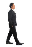 Side view Asian businesspeople walking Stock Photography