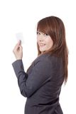 Side view of Asian Businesswoman show a blank card Stock Images
