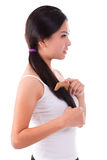 Side view Asian girl combing hair Stock Photo