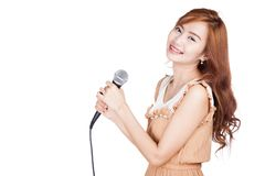 Side view of Asian girl hold a microphone Stock Photo