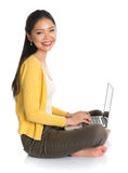 Side view Asian girl using notebook Stock Photos