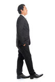 Side view Asian male walking Stock Photos