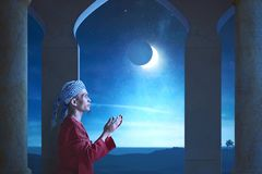Side view of asian muslim man praying stock photography