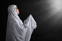 Side of view asian muslim woman wearing veil Stock Images
