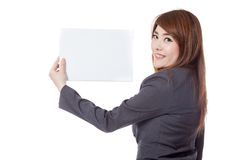 Side view of Asian office girl show a blank sign Stock Image