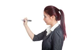 Side view of Asian office girl writing with a pen  Stock Photography
