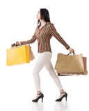 Side view of Asian shopping woman Stock Images