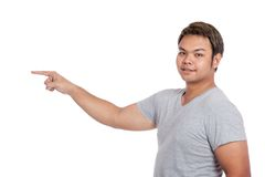Side view of Asian strong man pointing  look at the camera Stock Images