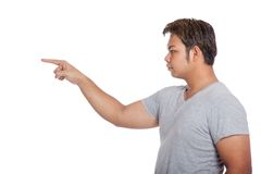 Side view of Asian strong man pointing wear casual dress Royalty Free Stock Photos