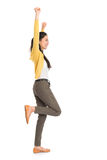 Side view Asian woman jumping Royalty Free Stock Images