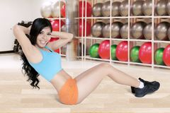 Young woman doing sit up exercise Stock Photos