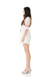 Side view of Asian woman with white short dress Royalty Free Stock Image