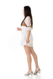 Side view of Asian woman with white short dress Stock Photography