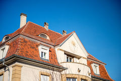 Side view of astronomical clock in on the facade of a house Royalty Free Stock Photos