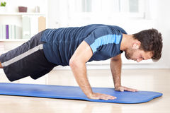 Side View of an Athletic Man Doing Push Ups Stock Image