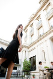 Businesswoman legs walking to meeting. Side view of an attractive elegant businesswoman walking to a business meeting in a luxury coffee shop terrace Stock Photography
