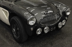 Side view of a  Austin Healey 100F old car. Switzerland Royalty Free Stock Photos