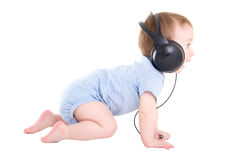 Side view of baby boy toddler with headphones isolated on white Royalty Free Stock Image